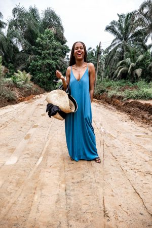 Atlanta fashion and lifestyle blogger Monica awe-etuk wearing a blue maxi dress in nigeria, nordstrom rack blue maxi dresses, black sandals, straw bag, hat bag, j.crew sandals, gladiator sandals, style blogger