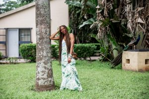 Atlanta fashion and lifestyle blogger Monica awe-etuk wearing a floral maxi dress in nigeria, nordstrom rack dresses, black sandals, troy burch brown mini bag-2