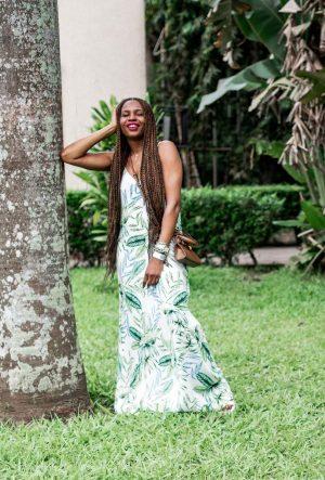 Atlanta fashion and lifestyle blogger Monica awe-etuk wearing a floral maxi dress in nigeria, nordstrom rack dresses, black sandals, troy burch brown mini bag