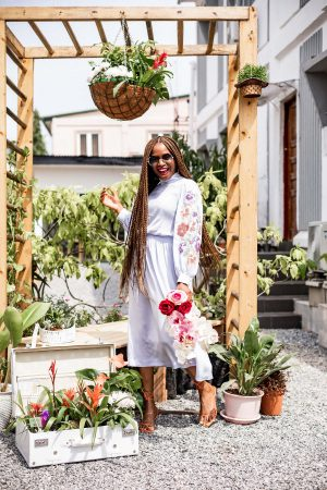 Atlanta fashion and lifestyle blogger Monica awe-etuk wearing & other stories blue midi dress at garden party, chanel round sunglasses, rejina pyo sandals, clear bag, floral dress, blue dress