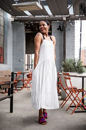 Atlanta fashion and lifestyle blogger Monica wearing a white and black maxi dress, chloe slides, straw bag and straw hat, stripe maxi dress, black and white maxi dress