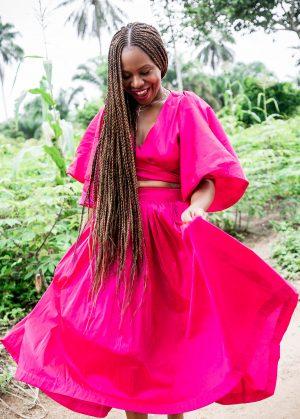 Atlanta fashion and lifestyle blogger monica awe-etuk wearing a pink crop top and midi skirt, black j.crew sandals, in nigeria, nigerian blogger