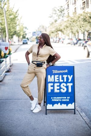 Atlanta fashion and lifestyle blogger monica awe-etuk at the tillamook melty fest tour in atlanta, wearing a boiler jumpsuit in brown, brown jumpsuit, gucci square sunglasses, white chanel sneakers, long braids, hair styles for black girls, jacquemus belt bag