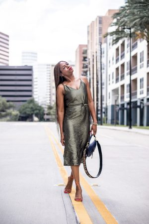 Atlanta fashion and lifestyle blogger monica awe-etuk wearing asos green fitted midi dress, orange sandals, and dior saddle bag, floral strap, dior, christian dior, style blogger, rejina pyo, influencer