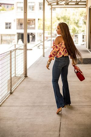 Atlanta fashion and lifestyle blogger monica awe-etuk wearing walmart fall floral top and high-waist flared jeans, brahmin red bag, gucci sunglasses, long braids, box braids, fall fashion, fall fashion trends, floral print, fall prints