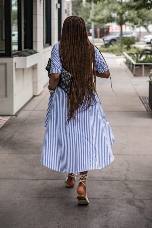 Atlanta fashion and lifestyle blogger monica wearing english factory high-low blue and white stripe top with white denim shorts, english factory, agold jeans, white jeans, white denim, stripe top, stripes, white sandals, j.crew sandals, long braids, box braids, dior bag, dior cluthc, dior oblige bag, atlanta blogger, top atlanta blogger