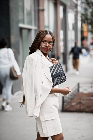 atlanta fashion blogger wearing asos 3-piece suit and dior clutch, prada lug sole polished leather creepers, extra large hoop earrings, long braids, black hair styles, aviator reading glasses, nyfw, fall trends, fall fashion guide, fall fashion, suiting trend, how to wear a 3-piece suit, how to style a suit, styling a suit
