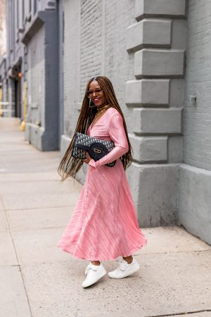 fashion blogger wearing rotate pink dress, white chanel sneakers, dior oblique oversized clutch, chloe sunglasses, dior choker, christian dior bag, christian dior choker, how to wear a pink dress, nyfw street style, how to layer necklaces, thick chains, how to layer big necklaces, oversized aviator sunglasses, white sneakers, white chanel sneakers,