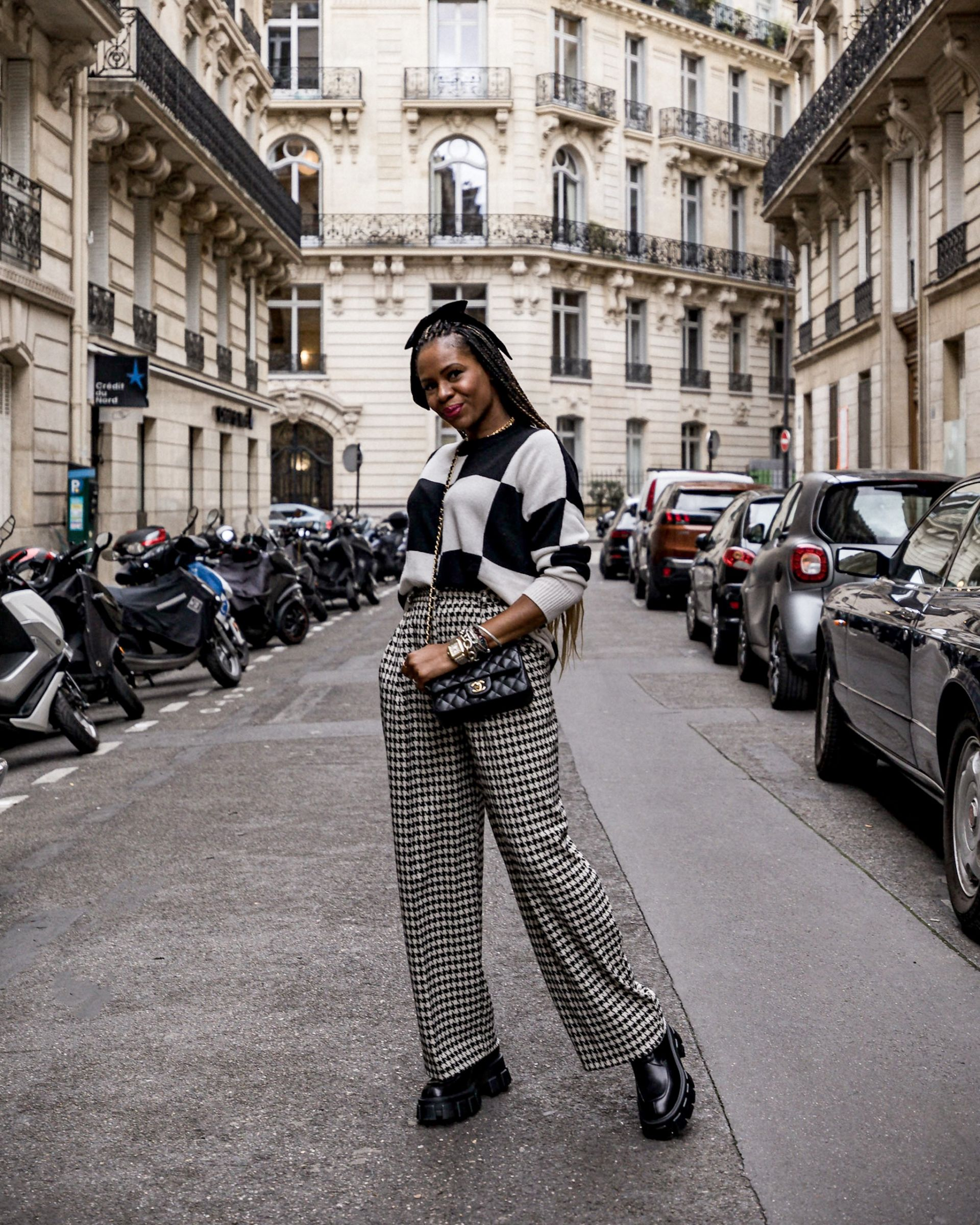 atlanta blogger wearing black and white autumn cashmere sweater and h&m houndstooth wide pants, prada creepers, bow in her hair, chanel chain bag, what to wear in pairs,