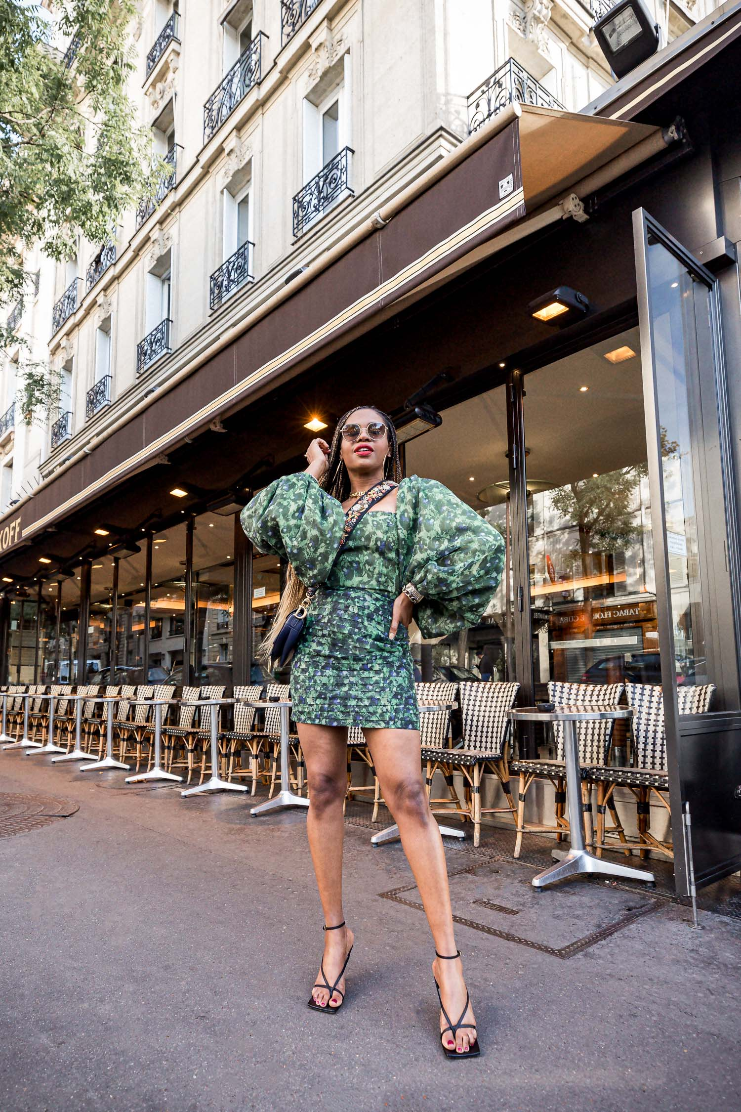 fashion blogger wearing green asiyami gold dress during paris fashion week
