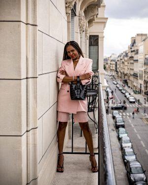fashion blogger wearing pink oversized suit and brahmin faith bag, frankie shop pink suit, oversized suit, short suit set, neta porter, bottega ventta stretch sandals, paris fashion week, pfw, what to wear to paris fashion week, double-breast suit, paris balcony, champs elyse paris