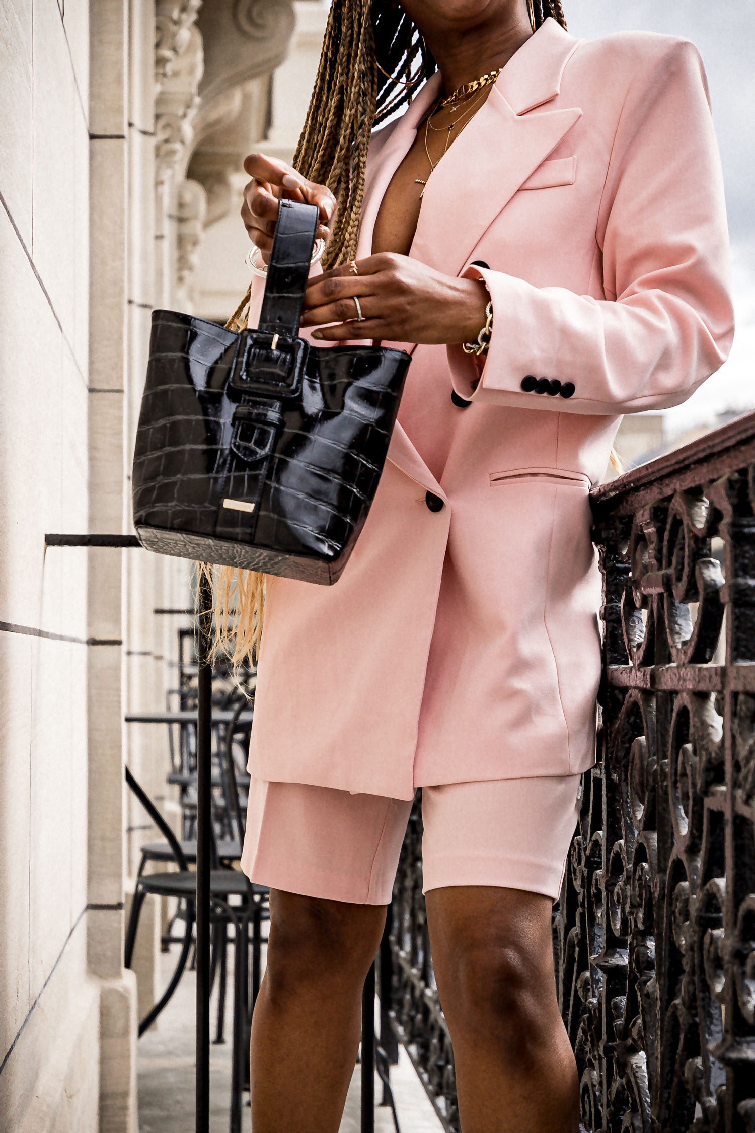 fashion blogger wearing pink oversized suit and brahmin faith bag, frankie shop pink suit, oversized suit, short suit set, neta porter, bottega ventta stretch sandals, paris fashion week, pfw, what to wear to paris fashion week, double-breast suit, paris balcony, champs elyse paris