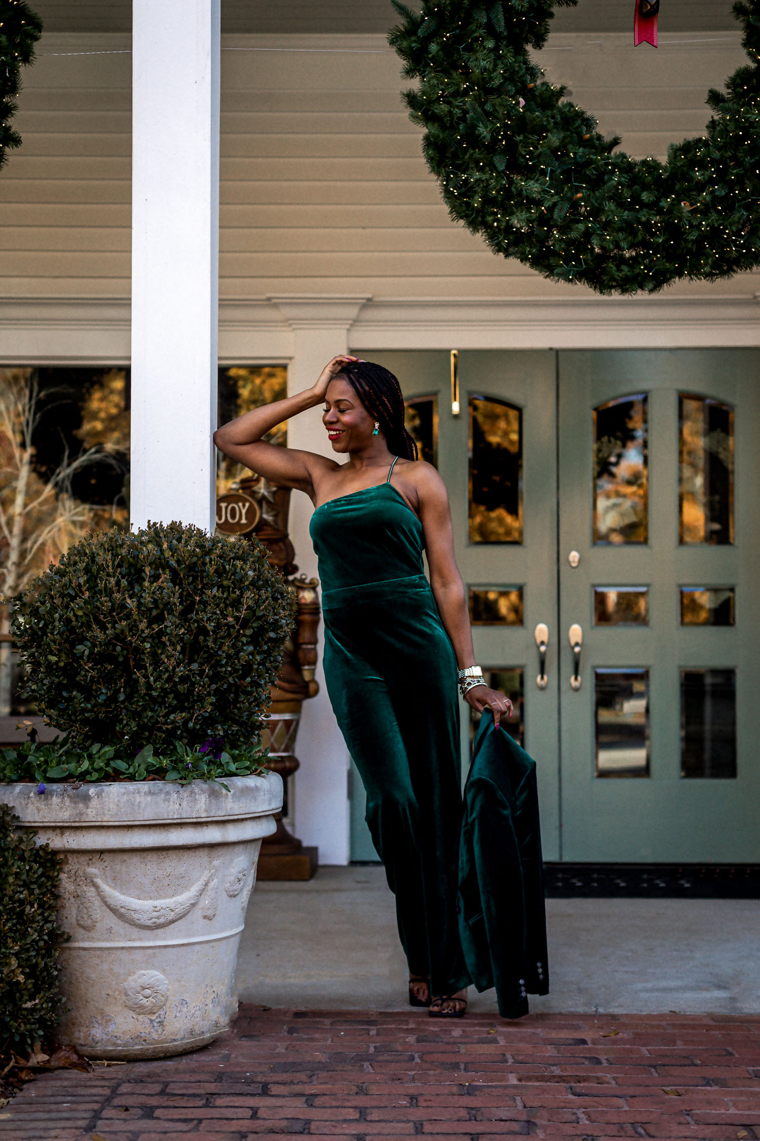 atlanta blogger wearing white house black market green velvet jumpsuit, green velvet blazer, bottega stretch sandals