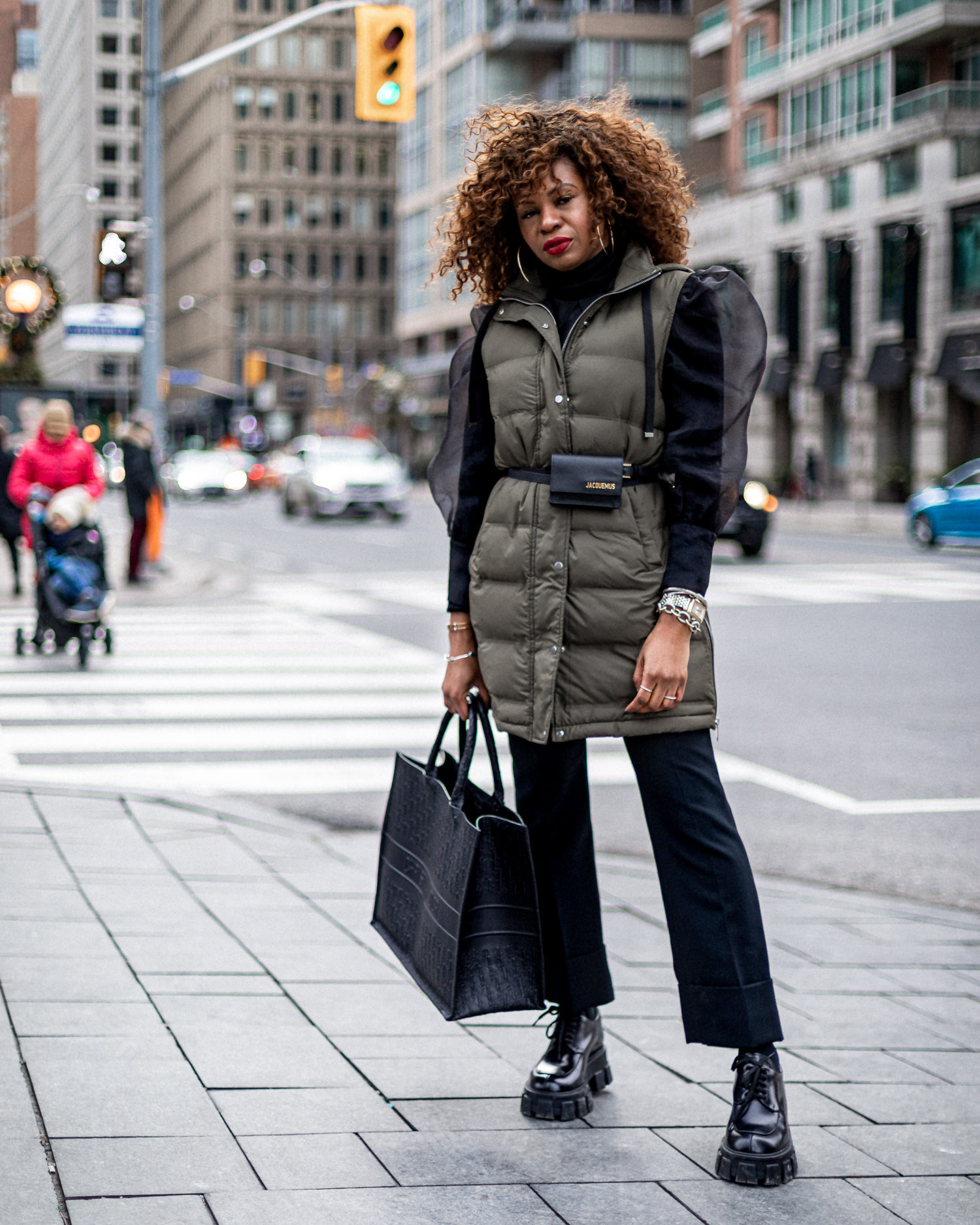 atlanta blogger wearing sleeveless puffer coat and prada creepers in toronto, dior book bag, crop pants, black pants, long vest, how to style a long vest, puffer vest, how to style a puffer vest, winter coats, toronto street style, coat trends, coat styles, top coats in 2020, coats to buy, what coats to buy in 2020