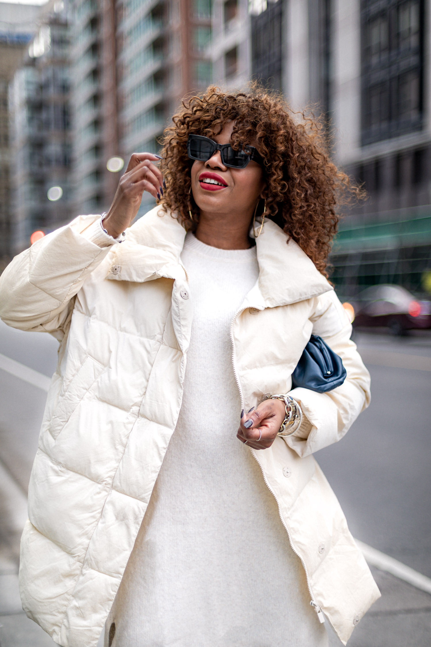 atlanta blogger wearing white puffer jacket, ivory sweater dress, how to style a puffer coat, how warm are puffer coats, why are puffer coats popular, why puffer coats are puffer, how to make a puffer coat chic