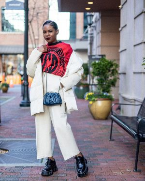 atlanta blogger wearing ruther carter for h&m sweatshirt, & other stories white crop pants, prada creepers, bottega clutch, navy bag, spring trends, spring transition outfit, transition looks, white coat, white puffer coat, ivory pants, ivory puffer coat, off white pants, how to style white in winter, how to style prada shoes, how to style creepers, how to style combat boots, how to make combat boots chic