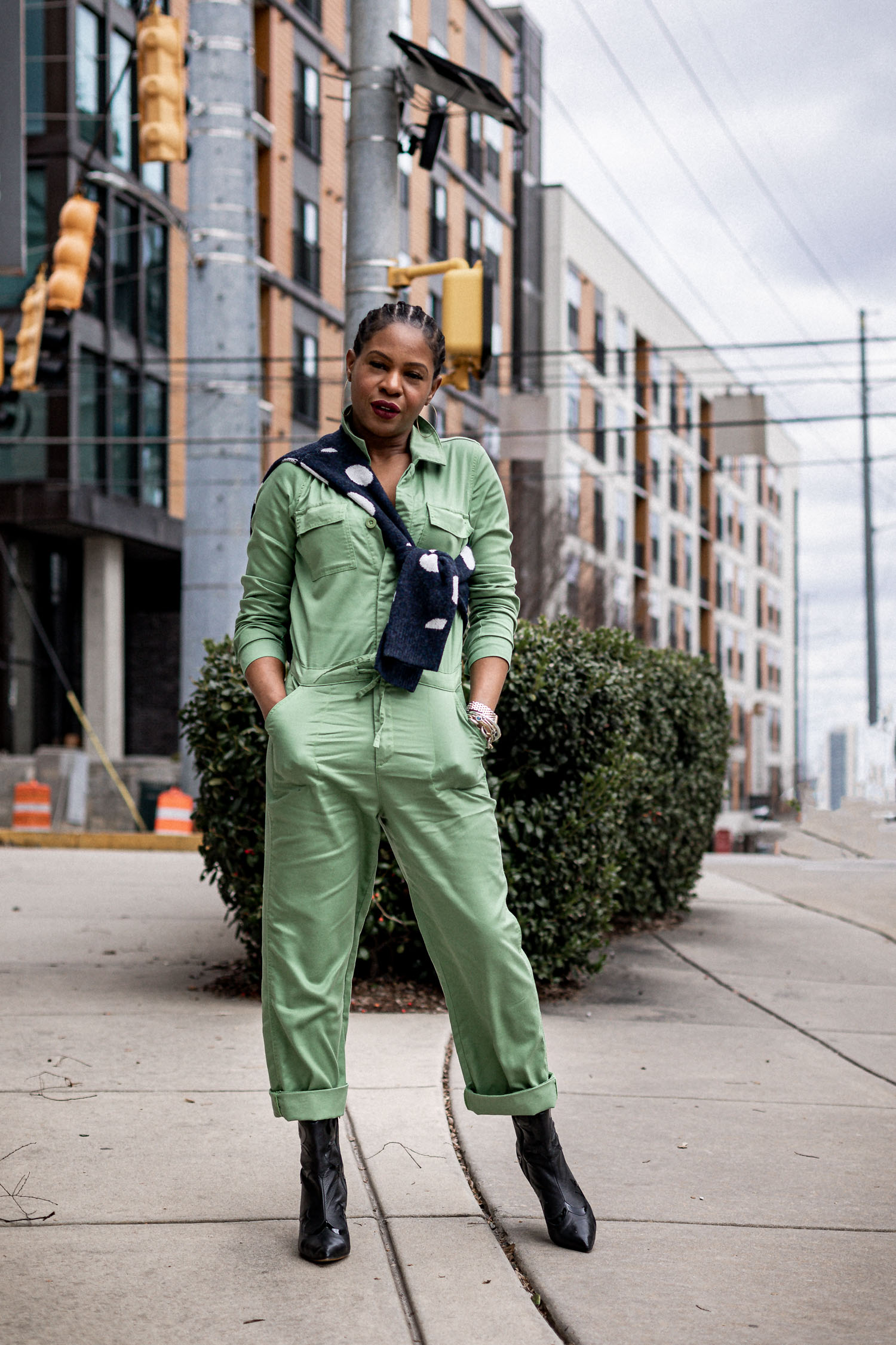 atlanta blogger monica awe-etuk wearing scoop at walmart green jumpsuit, walmart, scoop walmart, scoop, 2020 spring trends, how to wear spring trends, top spring trends for 2020, how to style pastel colors in cold weather , how to wear spring trends in cold weather, pastel colors, 2020 spring fashion, jumpsuit, green jumpsuit, how to wear a jumpsuit in cold weather, how to style a jumpsuit for spring, how to style a jumpsuit with boots, layering a jumpsuit