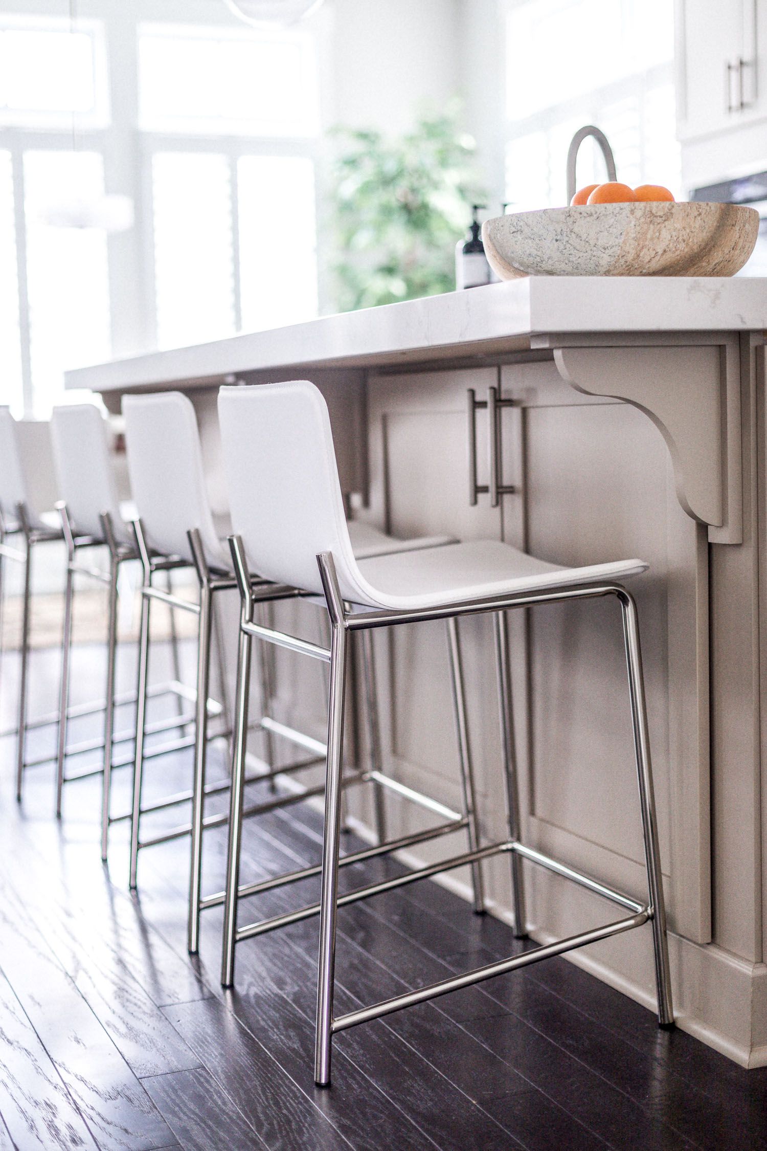 white counter stools, cb2, atlanta blogger monica awe-etuk reveals her white kitchen, home tour, white kitchen, how to keep a white kitchen clean, my dream kitchen, kitchen reveal, kitchen tour, white kitchen tour