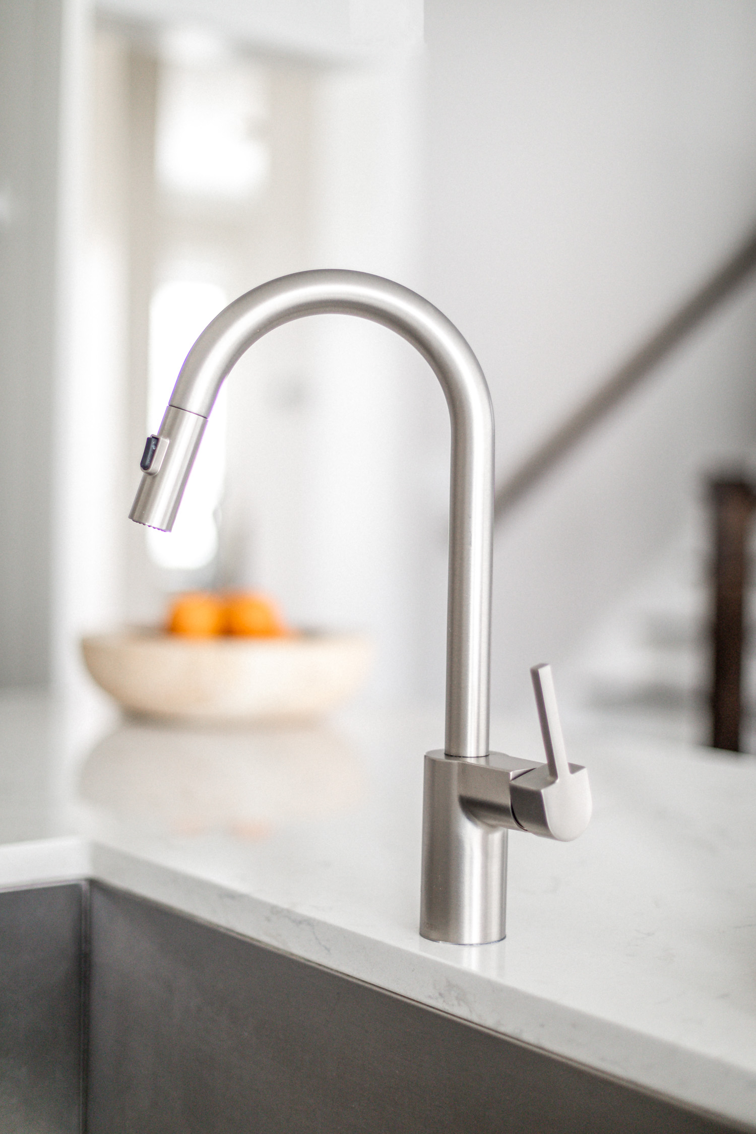 atlanta blogger monica awe-etuk reveals her white kitchen, home tour, white kitchen, how to keep a white kitchen clean, my dream kitchen, kitchen reveal, kitchen tour, white kitchen tour, faucet, moen faucet