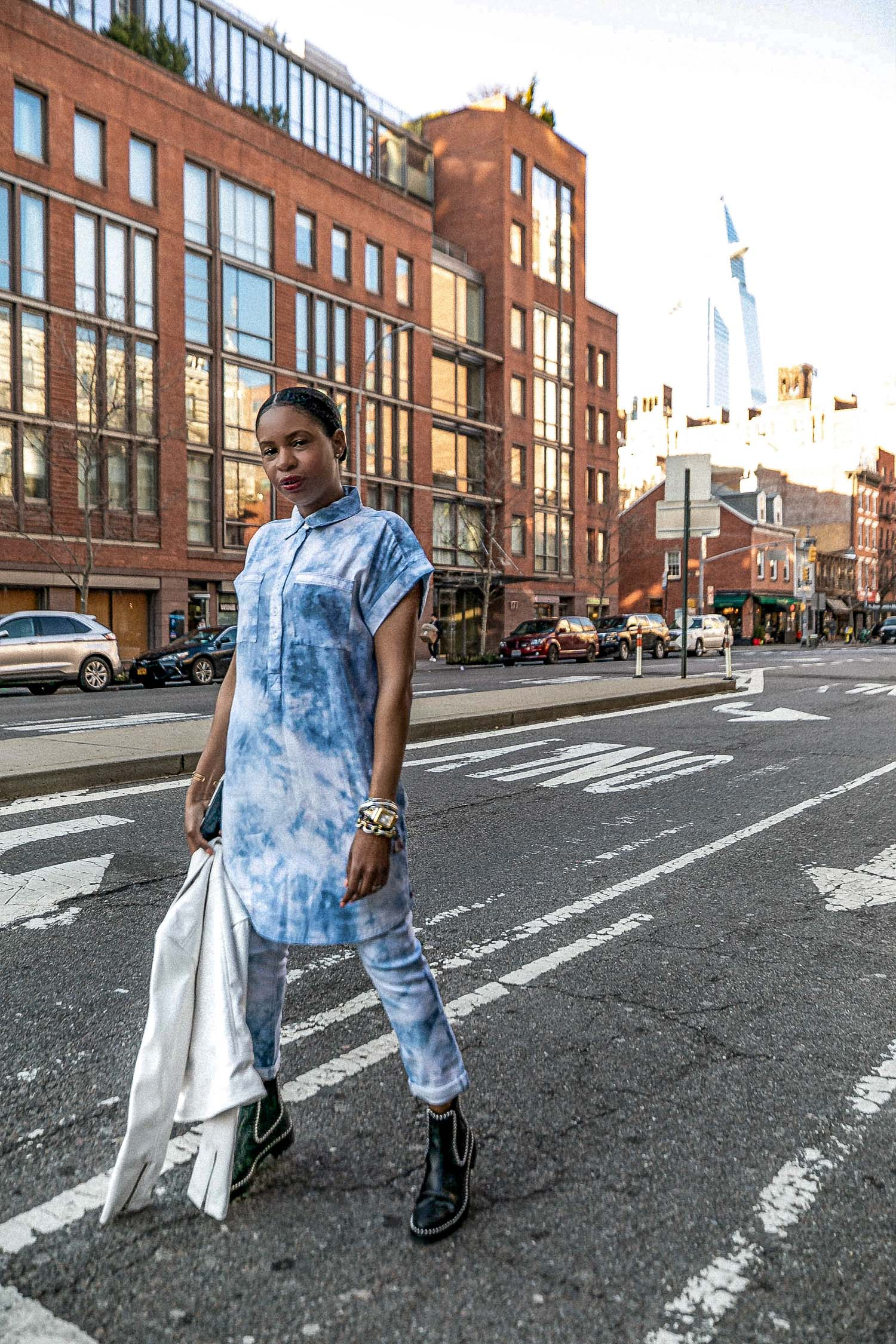 atlanta blogger monica awe-etuk wearing a tie-dye dress over tie-dye jeans from walmart, how to style tie-dye, how to style spring trends, how to style spring trends from head-to-toe, how to style blue and white tie-dye, what to wear with a tie-dye dress, how to style a dress over jeans, how to style tie-dye jeans, white biker jacket, how to style a white biker jacket, faux leather biker jacket, white leather jacket, combat boots, alexander wang combat boots, how to wear combat boots in spring