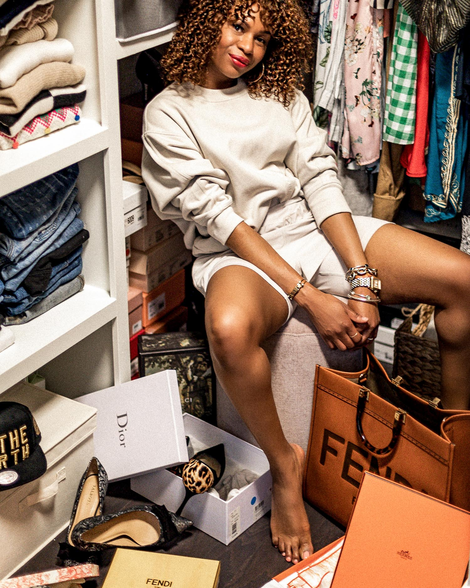 atlanta blogger wearing adidas by Stella McCartney in her closet, how to organize your closet, how to organize your closet