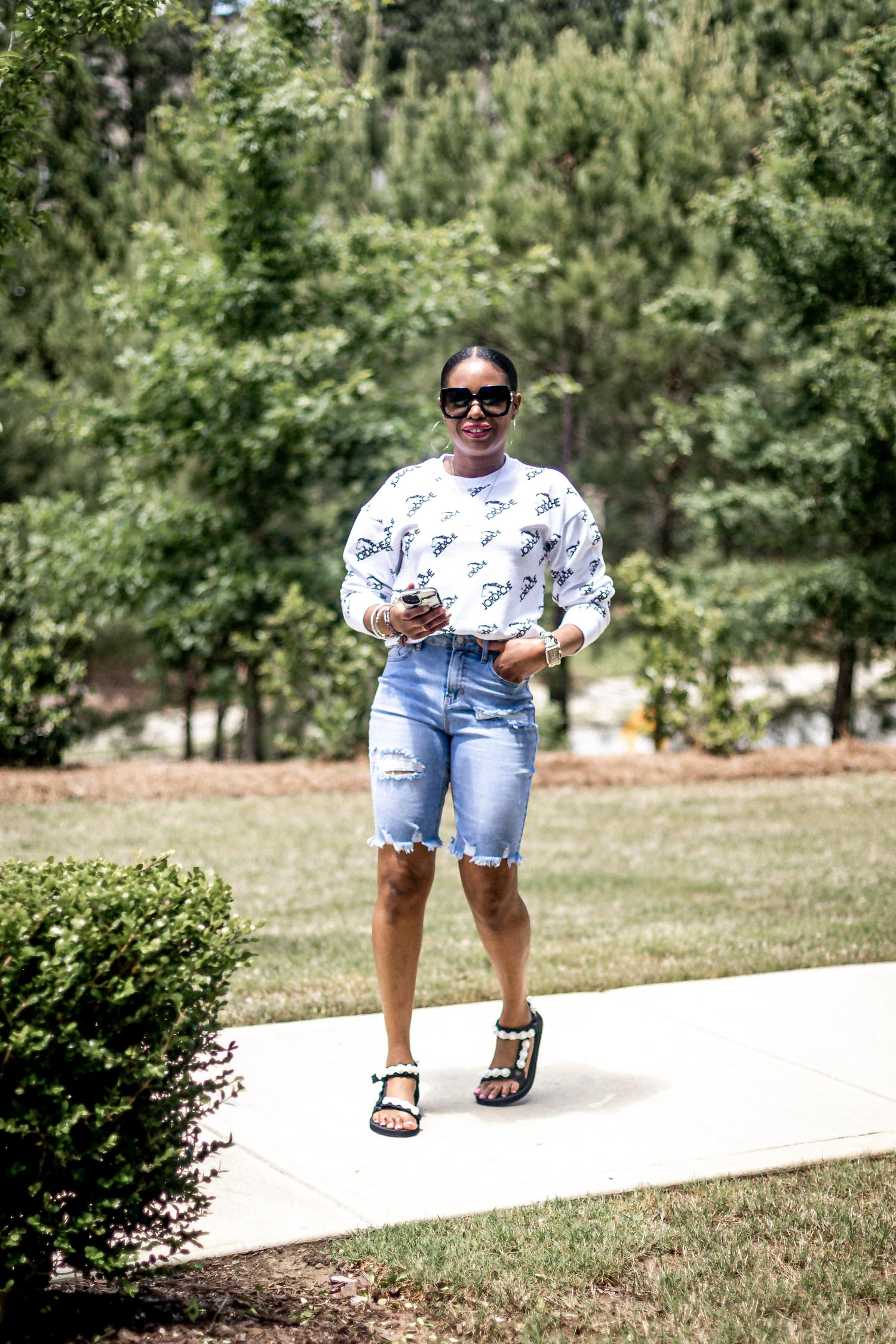 atlanta fashion blogger wearing the new jordache collection from walmart, high waist jeans, summer denim, how to pick the perfect denim for summer, summer denim, jordache high waist jeans, crop t-shirt, jordache tee, crop top, white crop top, what to wear around the house for summer, summer loungewear, best fitting jeans, best fitting denim, dark denim, dark denim shorts, how to style dark denim shorts for summer, the perfect shorts for summer, white t-shirt, how to style graphic t-shirts for summer, summer sweatshirts, bermuda shorts, how to style denim bermuda shorts, how to style denim bermuda shorts for summer