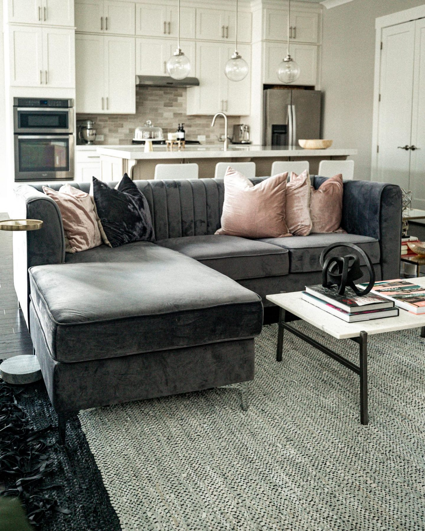 atlanta blogger reveals her new modern living room, living room tour, how to create a modern living room, how to create a minimalist living room, how to create the perfect living room, grey sofa, velvet sofa, marble coffee table, drink table