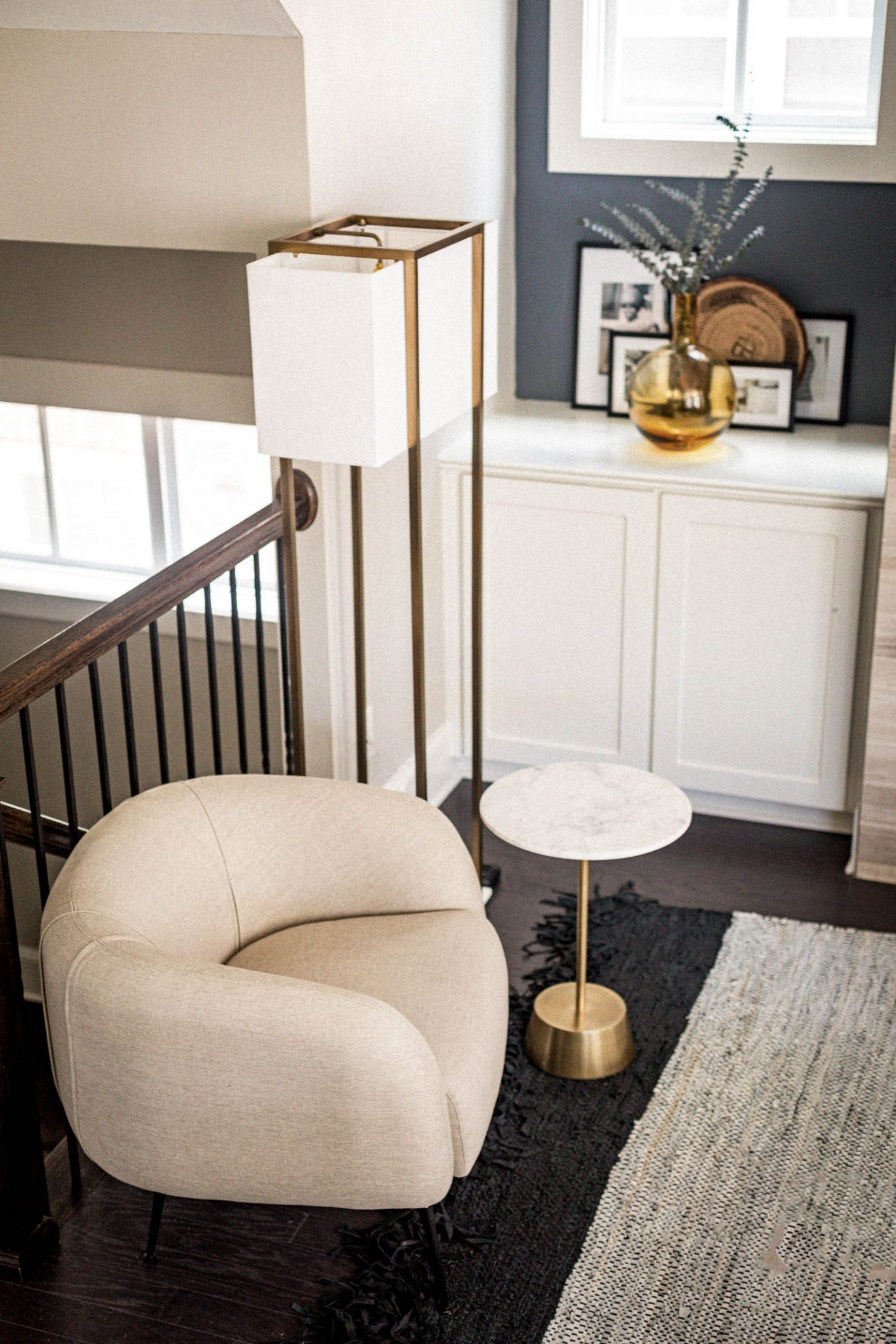 atlanta blogger reveals her new modern living room, living room tour, how to create a modern living room, how to create a minimalist living room, how to create the perfect living room, cream accent chair, marble side table, marble standing lamp, accent chairs