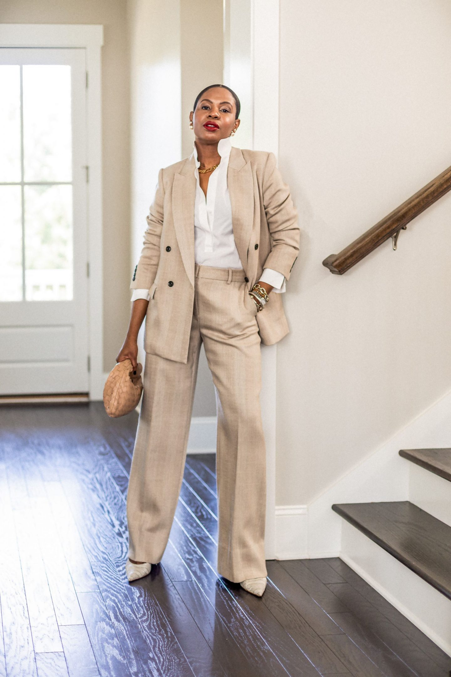 atlanta blogger wearing brown crop beige herringbone suit, beige boyfriend blazer, double breast jacket, crop trench coat, from m.m. lafleur, how to style a suit, what to wear to work, work looks, work outfits, work outfit inspiration, work lookbook what to wear to work, boy friend blazer, double breast blazer, white shirt, dior choker, how to style a dior choker, amina muaddi pumps, bottega knot bag, how to style the bottega veneta knot bag