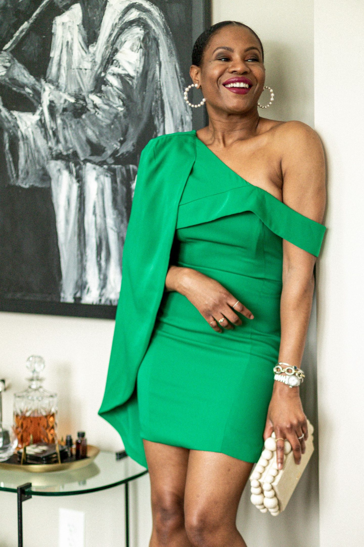 atlanta blogger wearing a green one sleeve dress for a holiday party, holiday parties, holiday dresses, zoom party