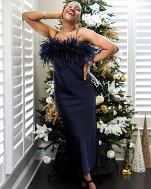 holiday alternative outfits for nye, what to wear at home for new year's eve, silk dress, navy dress, how to style a navy dress, feather dress, how to style a feather dress,